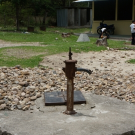 Defunct pump in schoolyard. It no longer produces water